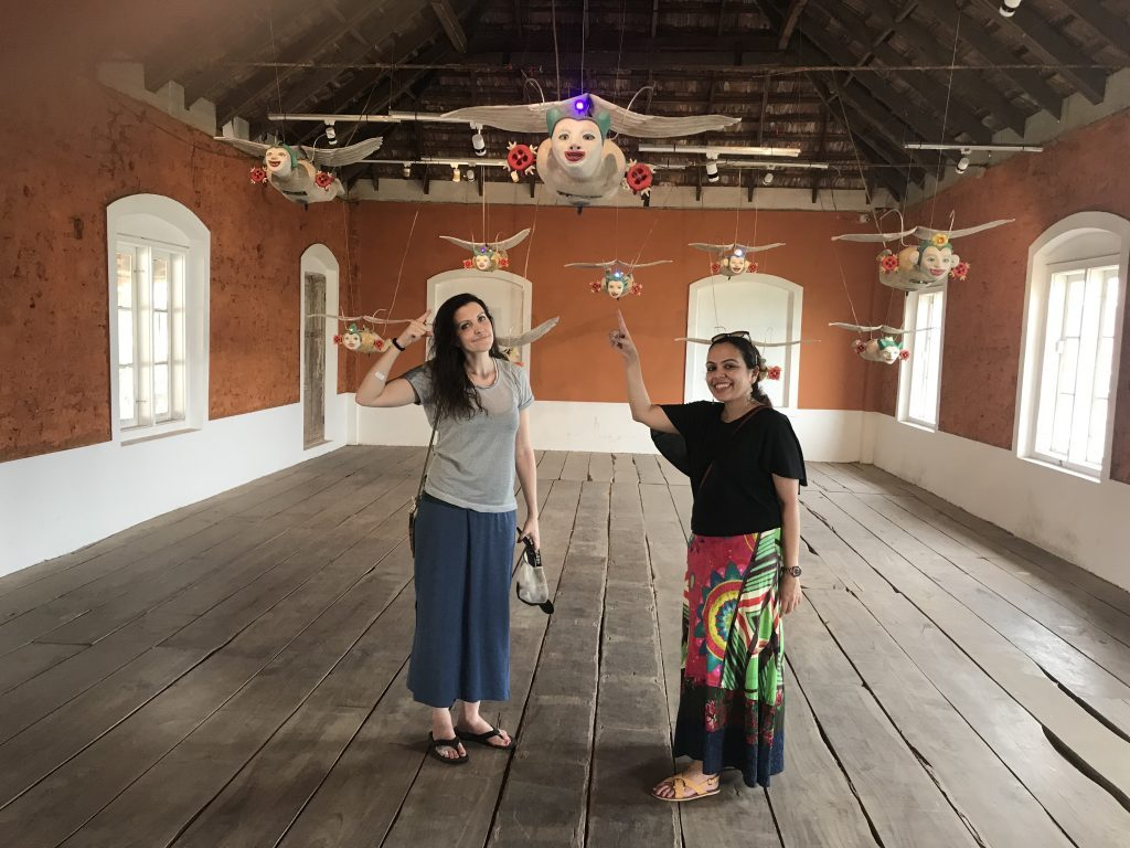 "Us enjoying Henri Dono's art installation ""Smiling angel from the sky' at the Kochi Muziris Biennale"